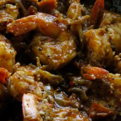 prawn vindaloo curry cooked in a pan