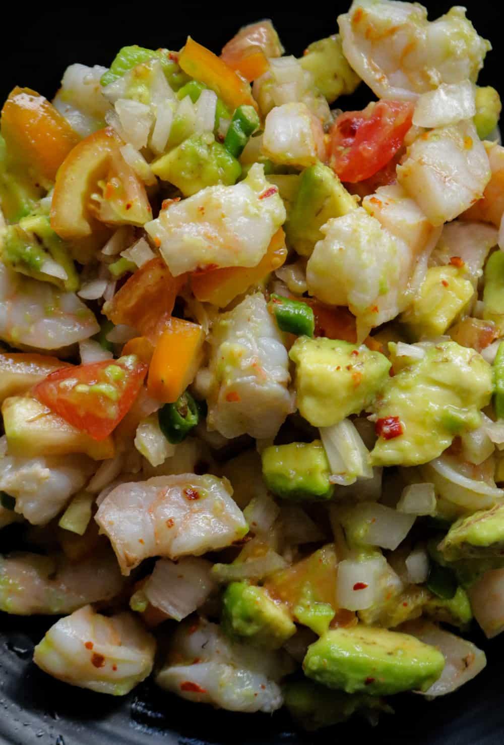 shrimp salad with avocado, onions, tomatoes.